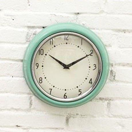 Add a little retro vibe to a home office or kitchen with this mid-century inspired metal wall clock. With its quartz-powered movement and crystal-clear numbering, it's ready to hang on any wall for just-in-time style.