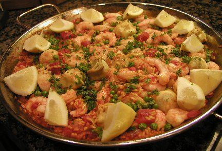 Spanish Shrimp Paella by Donna Hager: 4 servings. Ingredients: 1 to 1 1/2 pounds raw extra-large shrimp, peeled and deveined*   Coarse salt,   2 1/4 cups bottled clam juice or fish broth,   3/4 cup dry white wine,   1/2 teaspoon crumbled saffron threads**   2 tablespoons olive oil,   1/3 cup finely chopped onion,   1/2 red bell pepper, cored, seeded and chopped,   2 cloves garlic, chopped,   1 cup uncooked Spanish or Arborio Rice   2 large tomatoes, peeled and coarsely chopped,   2 teaspoons…