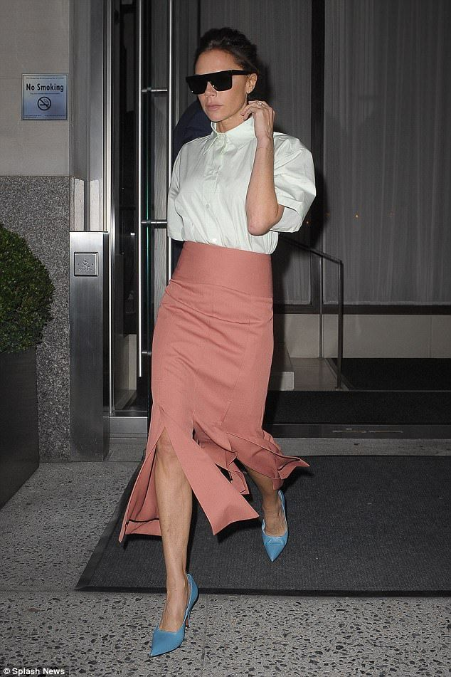 Svelte:The fashion designer cinched in her tiny waist thanks to the wide band of her flirty midi skirt, which featured several front-splits to show off her toned limbs