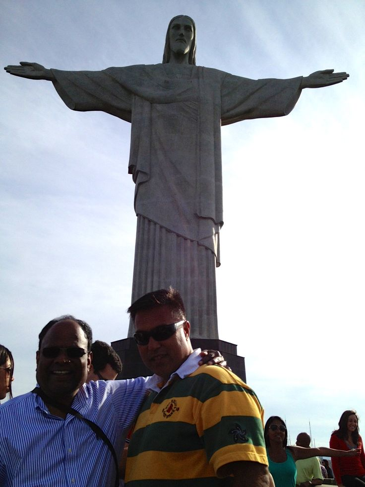 CEO, Raju and VP, Fred in front of statue of Christ in Rio de Janeiro.