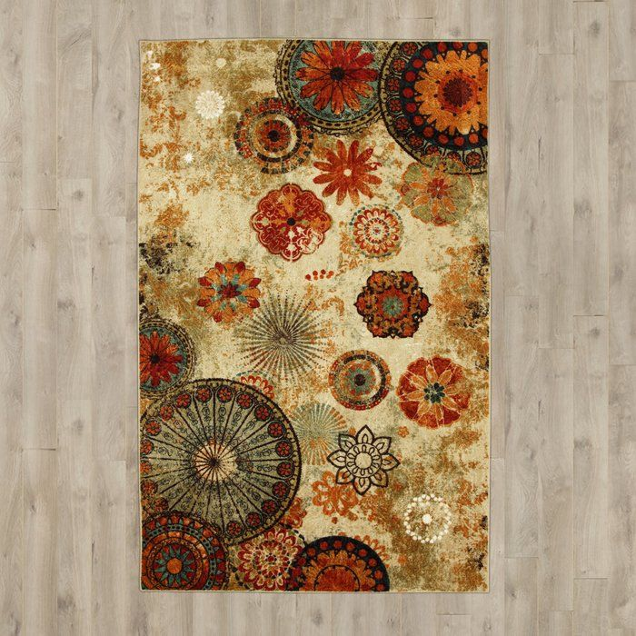 Bring an eclectic touch to your floors with this eye-catching area rug, featuring a simple tufted design, rubber backing, and bold patchwork medallion motif in a warm, earthy palette. Set it under a factory-chic steel and weathered wood dining table to tie your dining room together in loft-worthy appeal, then top it off with simple porcelain serveware, burlap table runners, and warm burgundy linens to call out this rugs red hues. If you're going for a bold look, try pairing it with rustic...