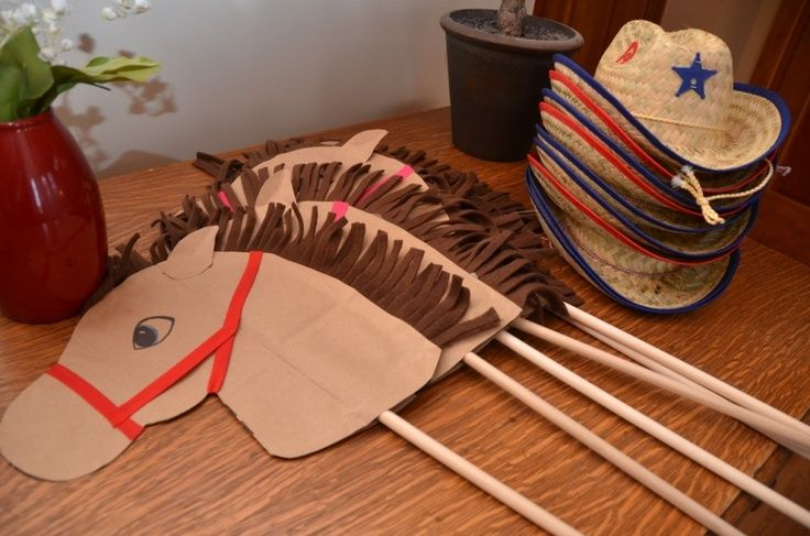 have the kids trace, cut out, and paint their own horse. glue on string or cut up construction paper for the mane. put on a popsicle stick!