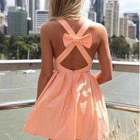 Pink dress with a bow in the back. So cute!!