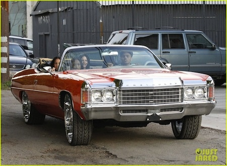 Chris Brown hanging out with a group of girls in his Chevrolet Impala. These girls are gonna be ok, right?
