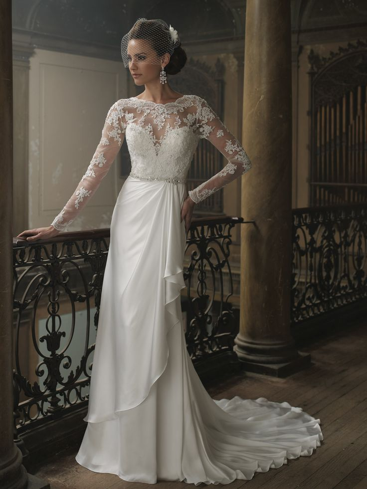 Sophisticated Styling Lends Classic Grace To This Exceptional Wedding Gown By David Tutera 213258 Bridal A Long Sleeved Sheer Lace Overlay Adds Light