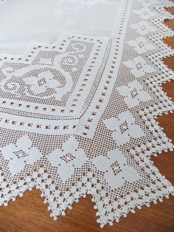 Vintage crocheted tablecloth with embroidery