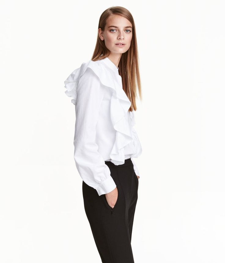 Check this out! Blouse in woven cotton fabric with a small stand-up collar. Concealed buttons at front, gently dropped shoulders, and slightly wider sleeves with buttons at cuffs. Large ruffles at front extending halfway down back. - Visit hm.com to see more.