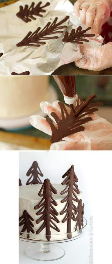 Draw Christmas trees on parchment paper using melted chocolate.