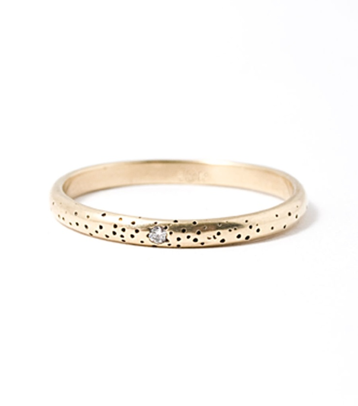 Claire's speckled band, in 14k yellow gold, really floats our boat. Sweet and understanted. With one subtle diamond.