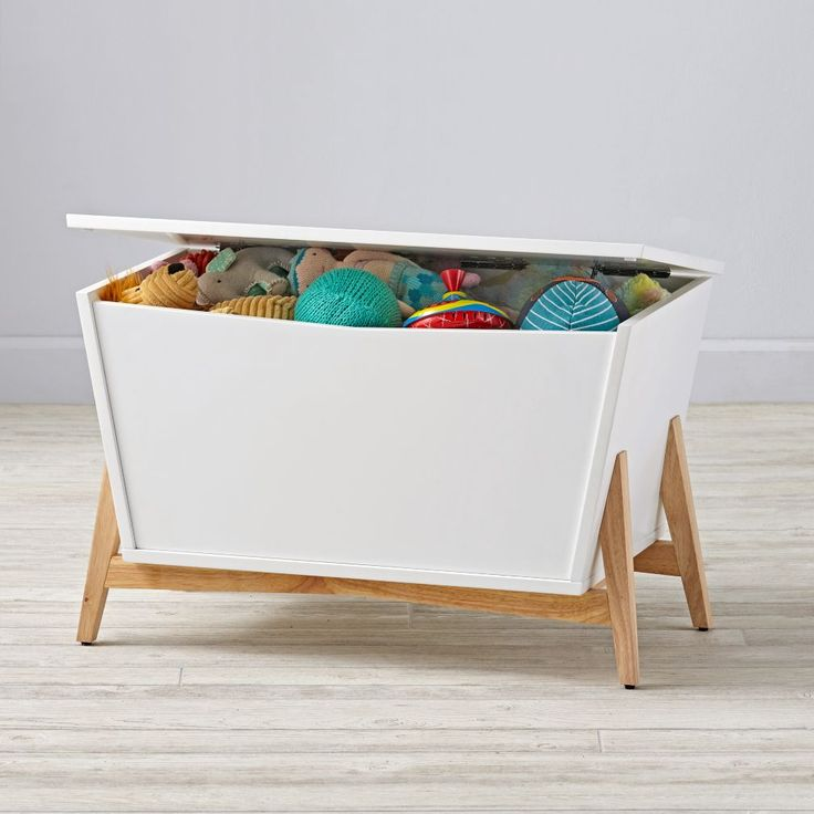 nest to sofa? Shop Parkside White & Natural Toy Box.  Sure, this modern toy box is roomy and functional enough to hold all your kids toys in the playroom.  But it's also stylish enough for you to be able to put anywhere in your home.