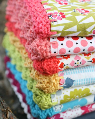 I NEED to learn to knit or crochet so I can do this to the edges of my blankets! (these are pillowcases though)