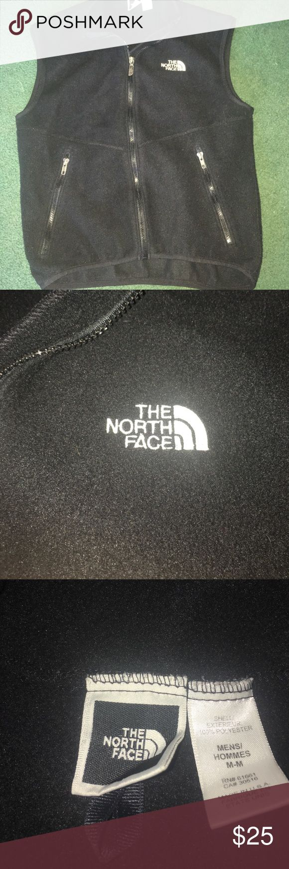 A black North Face zip-up vest. It's black with a zipper all the way down the front and zip-up pockets. The North Face Jackets & Coats Vests