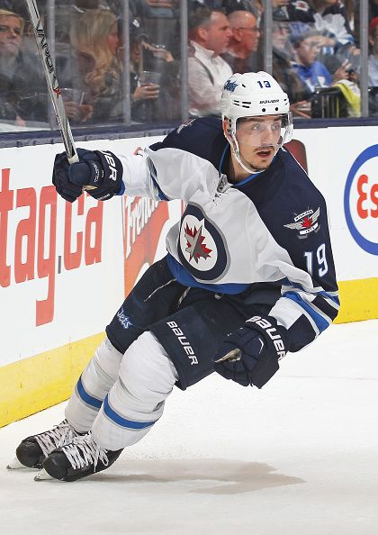 Nic Petan of the Winnipeg Jets skates against the Toronto Maple Leafs during an NHL game at the Air Canada Centre on November 4 2015 in Toronto...