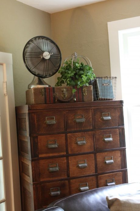 Love everything about this: the fan, the suitcase, the basket, and most of all the old repurposed card catalog!