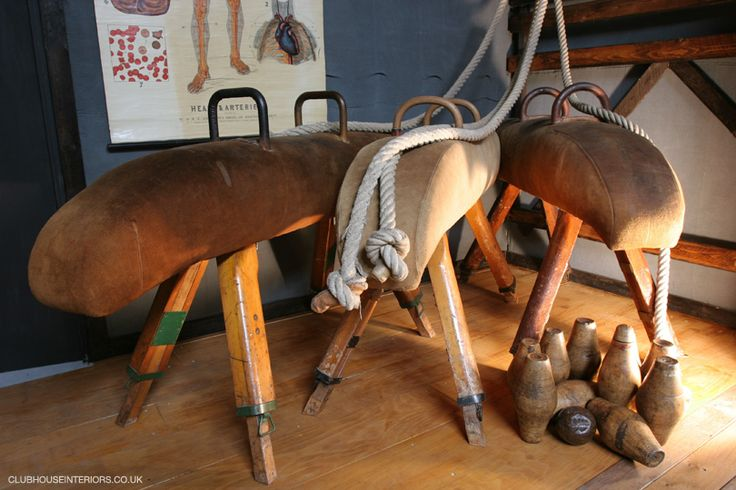 a collection of Restored Original Gym Equipment, such as Antique Gym Horse's, Climbing Ropes and a set of Vintage Wooden Skittles complete with Original Wooden Ball. Restored Sports Equipment, Vintage Games, Antique Sports Memorabilia. - Clubhouse Interiors