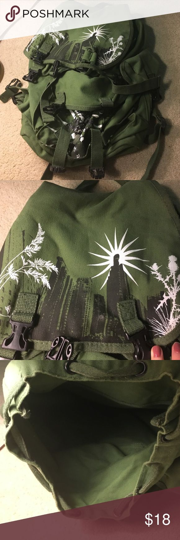 Army Green Backpack Great condition army green backpack with city designs! I think I used this maybe once or twice. Have too many backpacks! Send me an offer!! :) A little fading on the back! Bags Backpacks