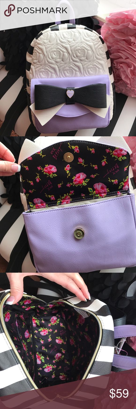 Betsy Johnson backpack Purple, black and off white backpack. Backpack measures 12 1/2 inches high , 10 inches wide. Adjustable straps on back. Floral lining. Betsey Johnson Bags Backpacks