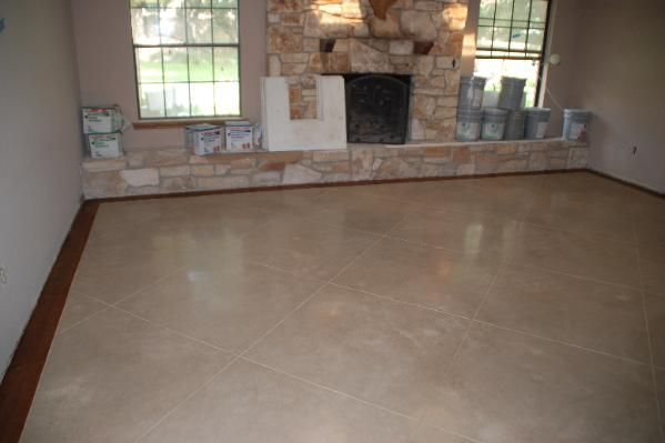 Stained concrete floors below new construction stain for Concrete floor stain colors