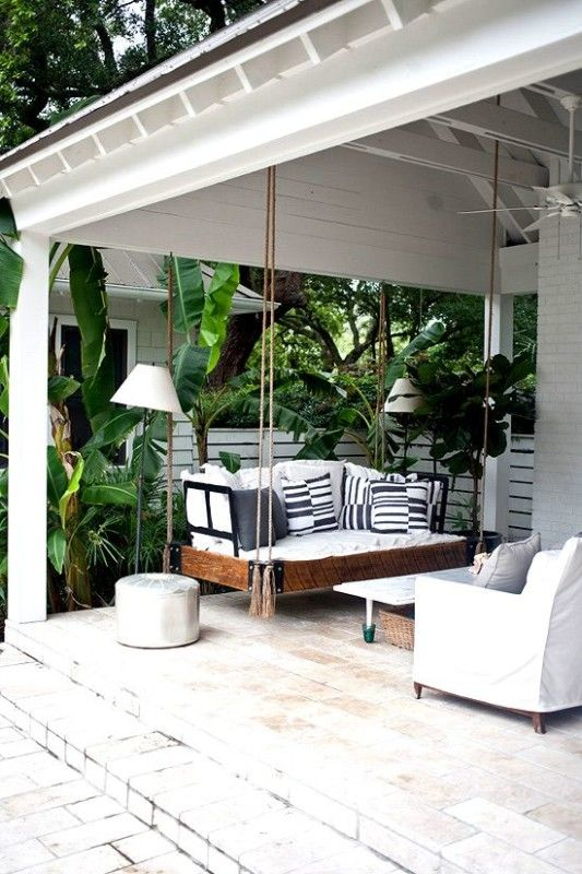 Create a relaxing front patio with a porch swing daybed your whole family can use to relax. We've rounded up our favorite awesome options that are perfect for decks of beach homes or other homes.