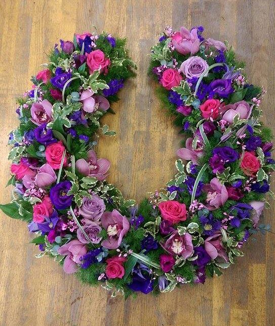 Beautiful horse shoe shaped tribute created by the expert team at Isle of Wight Flowers http://www.isleofwightflowers.co.uk/occasion-14/funeral.htm