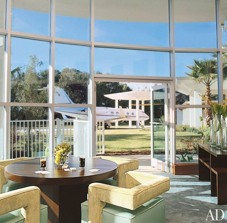 In Plane sight. A games table sits in the great room of John Travolta and Kelly Preston's Florida home, in view of the private jet outside.