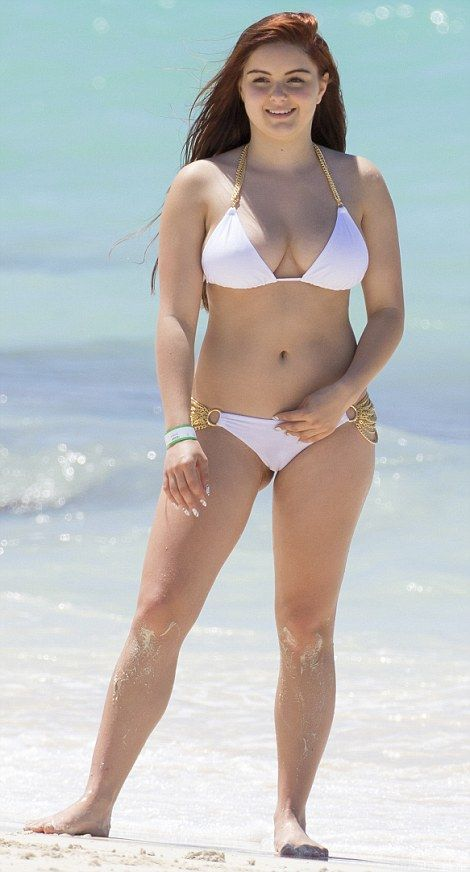 Beach babe: Ariel Winter was far from her geeky TV persona as she frolicked on the beach in the Bahamas last week