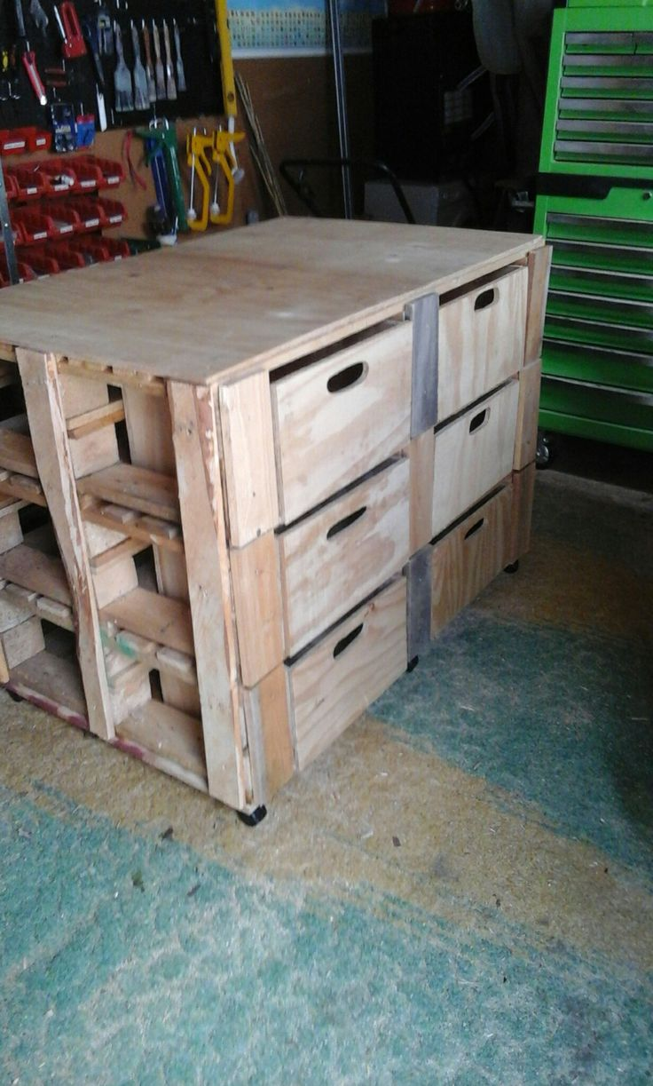 Floating work bench on Castors draws in front timber slots in back. Made of old pallets