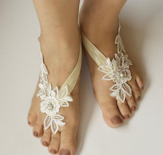 Light Ivory Beaded Lace Wedding Barefoot Sandals, Bridal Foot Jewelry, Footless Sandal, Customizable Handmade-SD018  These stunning Lt Ivory lace footless sandals are the perfect accessory for a beach or garden wedding. They are made with a lace applique and satin band. They are very comfortable and adjustable. Model Size is US 7.5; sandal color is It ivory applique and ivory satin band . These sandals can match the Light Ivory Beaded Lace Wedding Garter Set Measurment- Applique Size:6.5…