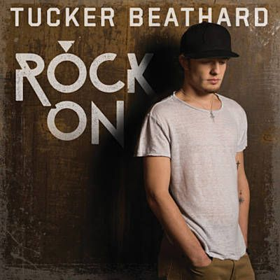 Tucker was one of the opening acts for Dierks Bentley. Like his voice. He's good live! ~D (Rock On - Tucker Beathard)