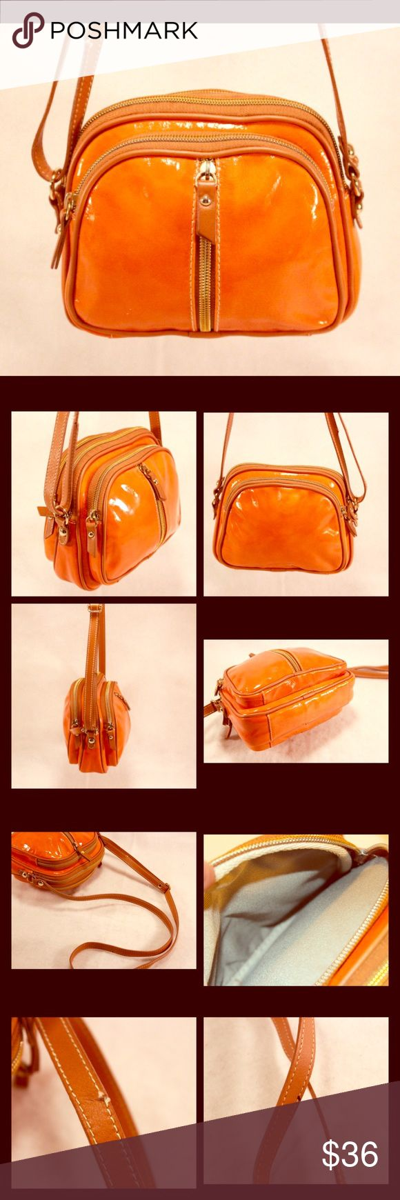 """VALENTINA Italia Orange Purse with Tan Leather VALENTINA Italia Orange Purse with Tan Leather. Made in Italy. Orange Material is Patent Leather. Four Zip Compartments. 9 x 7 x 2.5 with Adjustable Shoulder Strap Now Set to 20"""".  Orig. $ 148. Valentina Italia Bags"""