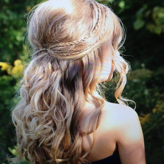 Curl hair...tease crown...pin back with braids on each side.