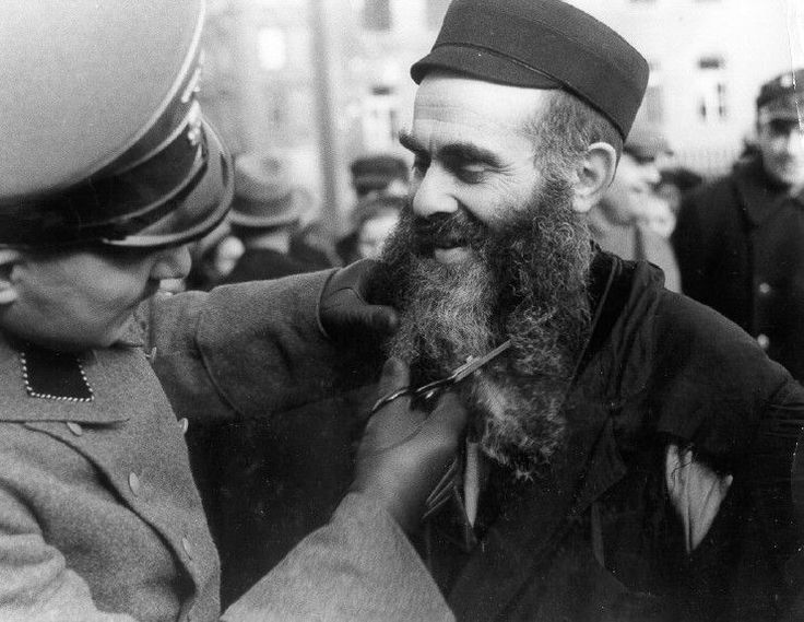 ss man cuts off a jews beard in poland jewish