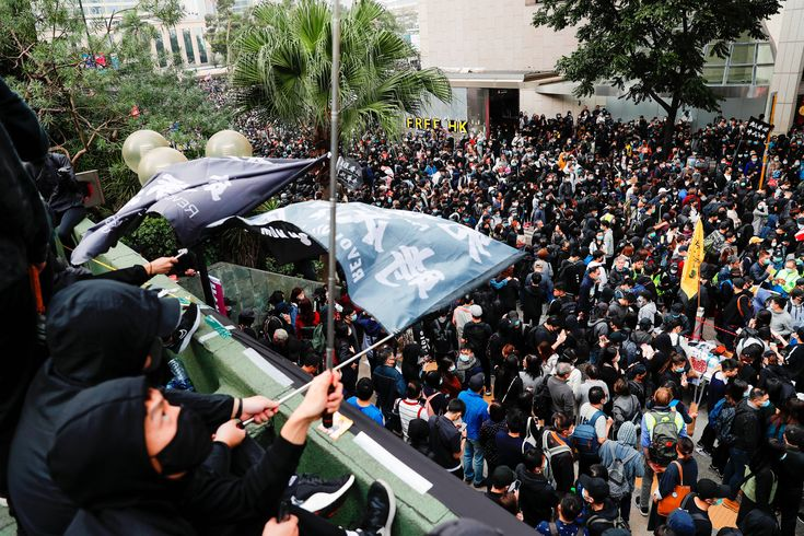 Hong Kong police arrest well-known activist after protest rally turns violent