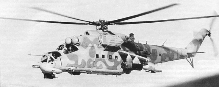 """A soviet Mil Mi-24P """"Hind"""" gunship helicopter flying over the skies of Afghanistan, date and location unknown."""