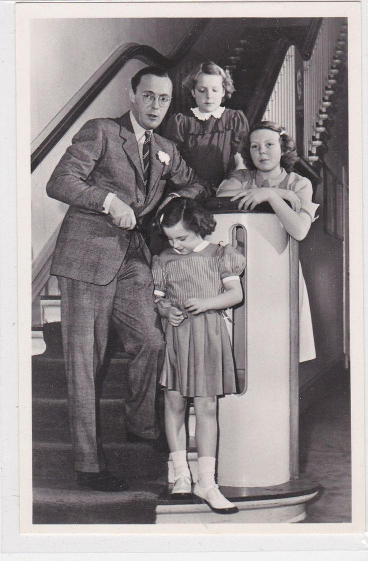 Prince Bernhard of the Netherlands with three of his six daughters.  Queen Juliana's mother and maternal grandmother, the queens Emma and Wilhelmina, only had one child each.  Juliana had six.  The Netherlands certainly got their money's worth out of Prince Bernhard.