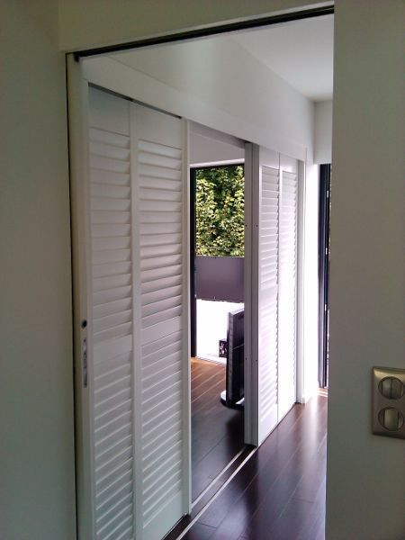 Jasno shutters france porte coulissante jasno shutters for Portes persiennes pour placard