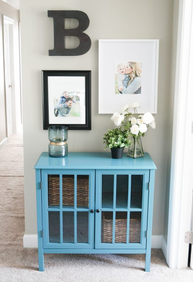 "There was this little wall at the top of the stairs that became a ""catch all"" area. I never really thought about it until I realized it could be fun to create a little gallery wall on it! Check out more details on my post ""Giving purpose to an otherwise overlooked wall"""