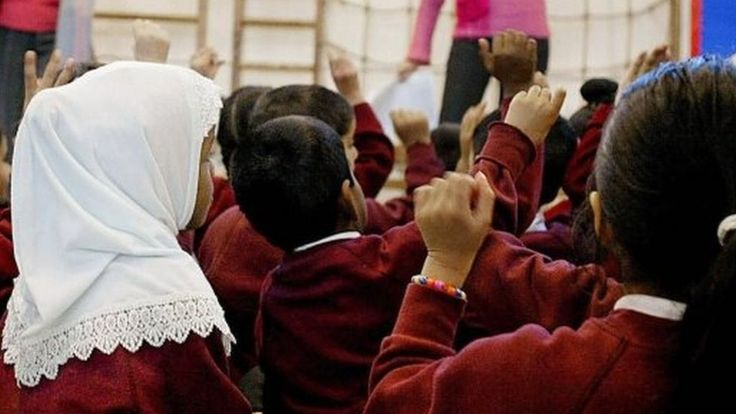 Ofsted's head says making very young Muslim girls wear headscarves could be seen as sexualisation.