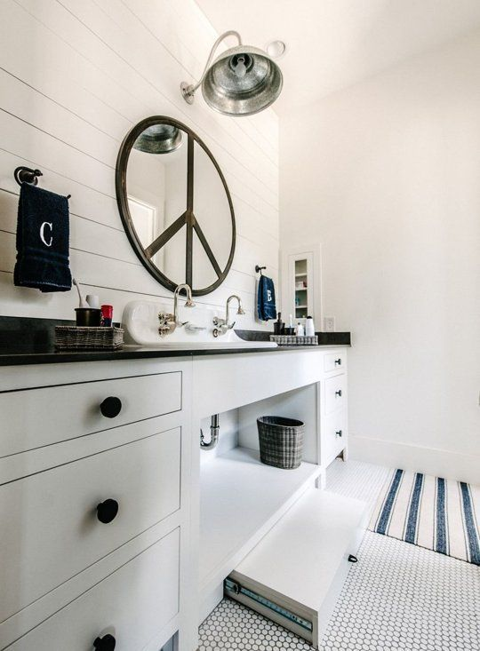 country farmhouse bathroom with pullout stepstool for children, recessed medicine cabinet with glass door (but that mirror is useless)
