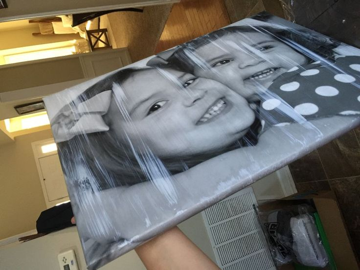 She lays a Walmart canvas face down on her table. When she flips it over? I love this family photo idea!