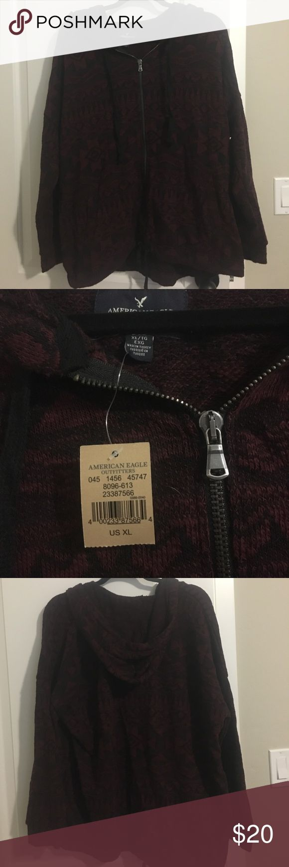 NWT AE zip up hooded sweater XL Brand new with tags American Eagle zip-up hooded sweater. Color is darker cranberry and black Aztec type design. Hood and waist both have ties. Cozy and cute! American Eagle Outfitters Sweaters Cardigans