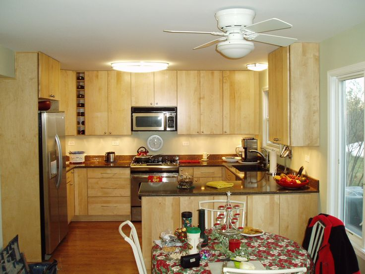 Not as much fond of the cabinets as the layout, with the peninsula from the right and the really tall top cabinets to make use of a high ceiling.