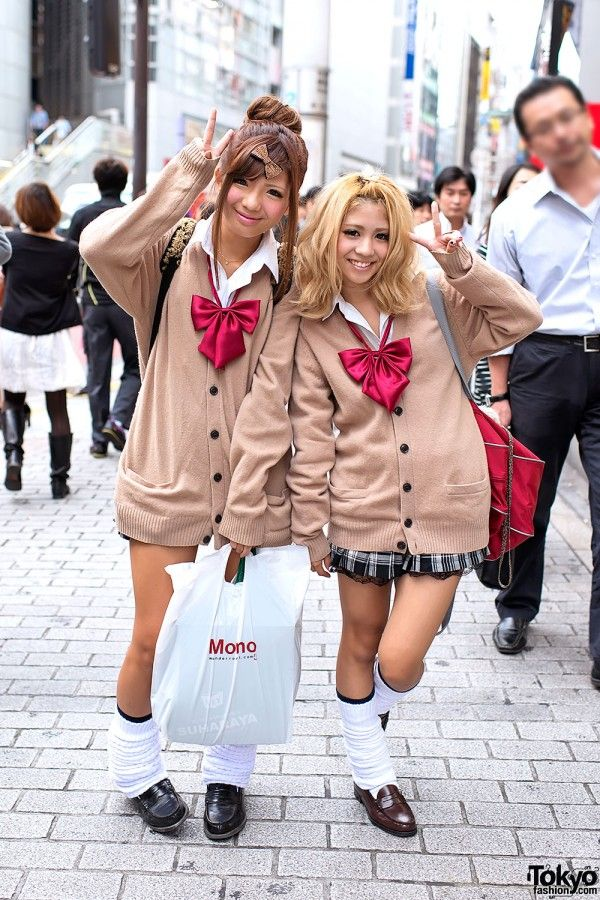Kogal/Kogyaru fashion involves wearing an outfit based on a Japanese school uniform, but with a shortened skirt and loose socks. The phenomenon was prominent in the 1990s, but has since declined. Kogals favor platform boots, makeup, and Burberry scarves. They may also dye their hair brown and get artificial suntans. They have a distinctive slang peppered with English words. They are often, but not necessarily, enrolled students.: