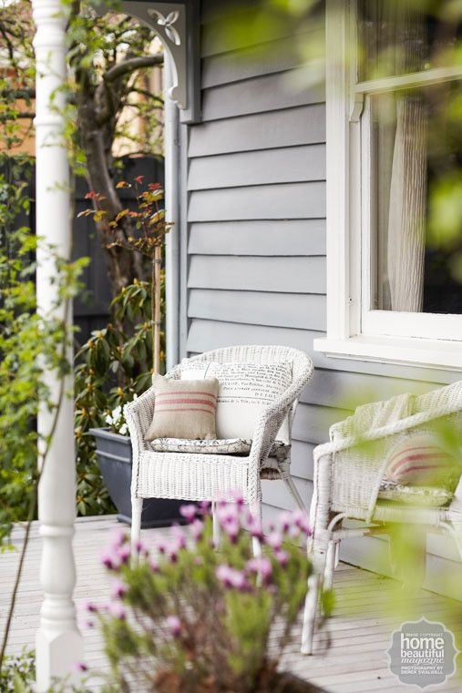 Rustic Retreat: grey-painted cladding and pots sit harmoniously with the blue and silver plants.