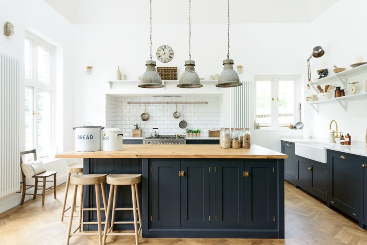 This beautiful deVOL arts and crafts kitchen in Kent mixes our Pantry Blue Shaker cabinets with with lovely Bella Brass knobs and handles