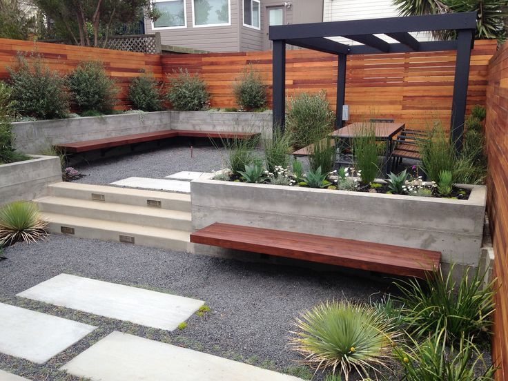 Growsgreen Landscape Design Beth Mullins concrete walls, ipe bench, cedar horizontal board fence, modern trellis, succulents. Growsgreen.com