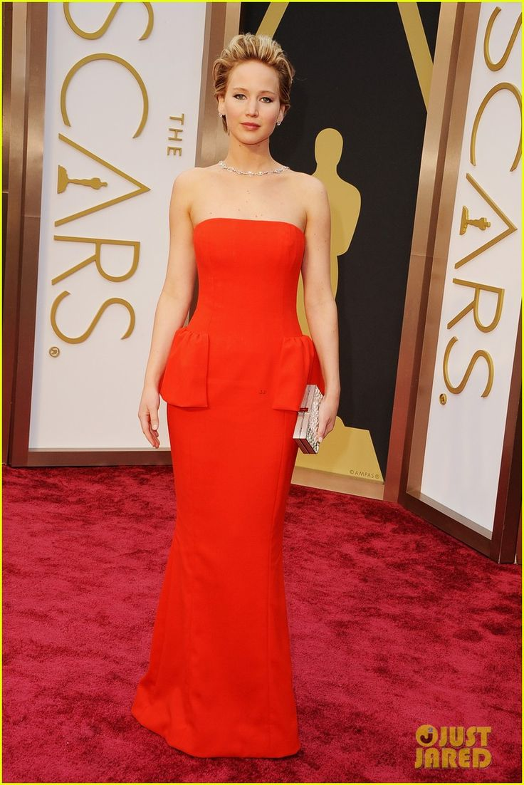 Jennifer Lawrence - Oscars 2014 Red Carpet. Jennifer is wearing a Dior dress, Brian Atwood shoes, a Ferragamo bag, and Neil Lane jewelry.