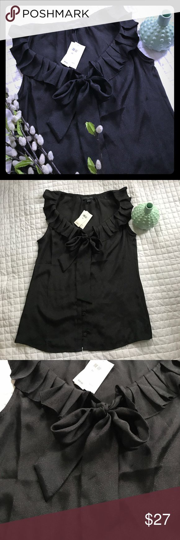 NWT Banana Republic Ruffle Bow Tank Top Brand new with tags, no defects! Soft silky feel, unique details! All of my items come from a clean, smoke-free home! Please look over the photos and let me know if you have any questions! Check my closet for more items and save when you bundle! Banana Republic Tops Tank Tops