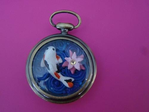 Koi Pond in Pocket Watch. Polymer clay sculpture with crystal flower center. Craftster DIYODS   www.craftster.org