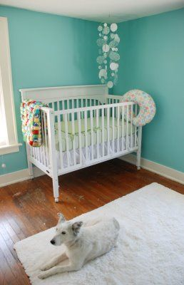 """Nursery painted the same color as the teal guest room, Behr """"Jamaica Bay"""". I would have darker furniture though... the white is too stark!"""